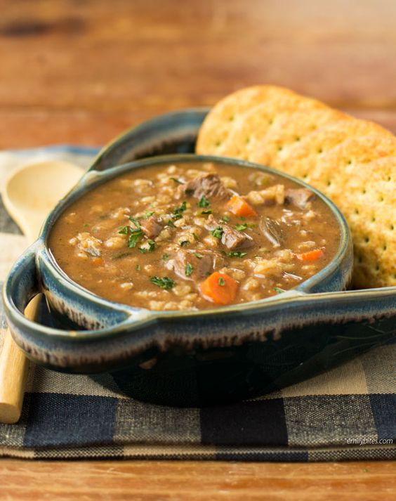 This Slow Cooker Beef and Barley Soup is the perfect warm, comforting winter soup. Such an easy recipe - just toss it all in the crock pot! Only 275 calories or 7 Weight Watchers Points Plus for a hug serving. www.emilybites.com