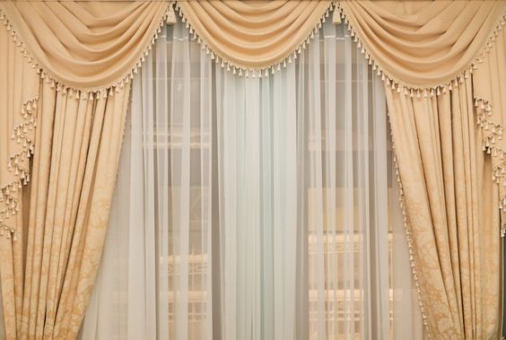 Combine Drapes With Curtains To Give A Magical Look