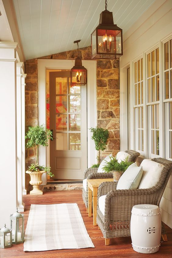 Decorate a small porch or balcony with a pair of chairs, a side table, and a garden seat. That's all you need! #porch #lantern #stone #traditional #decorating
