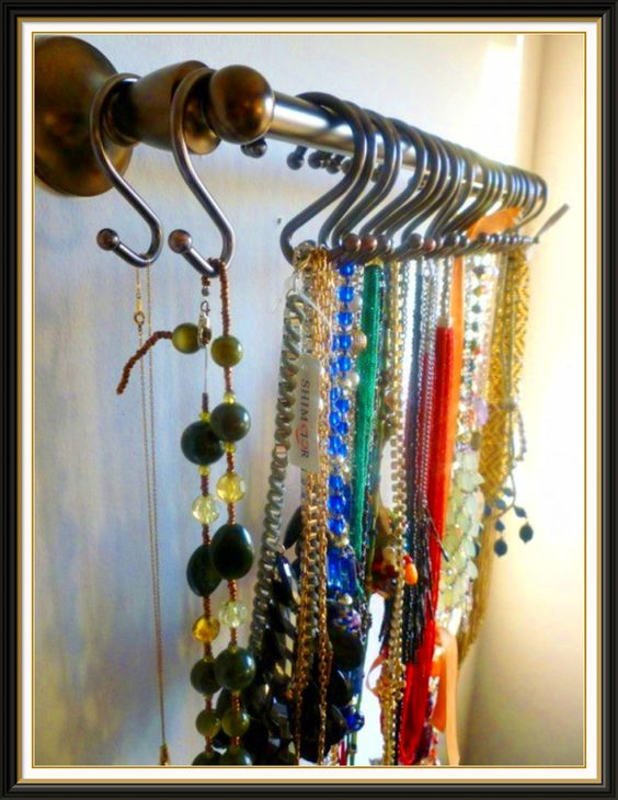 Necklace rack using a towel rack and shower curtain hangers