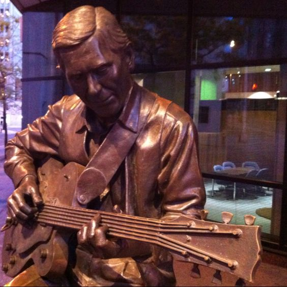 Sitting in with the statue version of Chet Atkins as the music plays in my head. ;-)