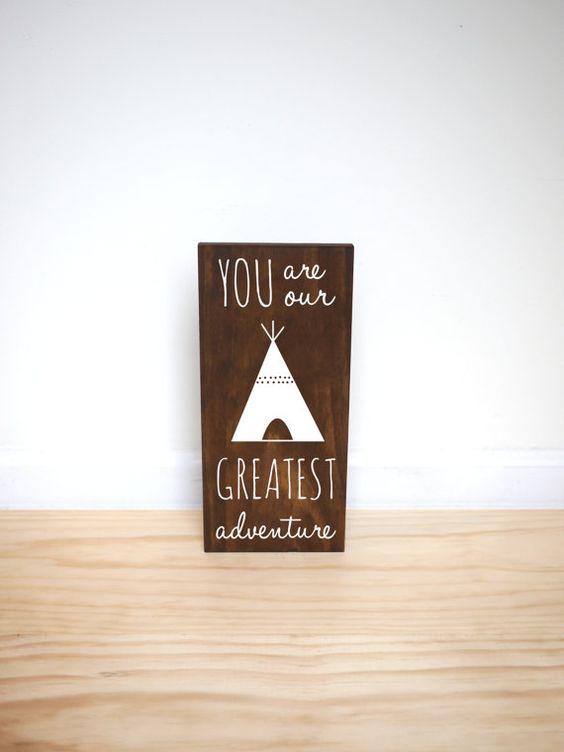 The perfect addition to a woodland, adventure, outdoor or tribal themed room! This solid pine wood sign features a dark walnut stain and white