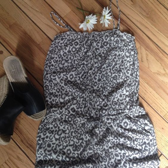 Animal Print Pant Romper Grey & cream print with drawstring waist & adjustable spaghetti strap. Size is extra small. I am usually a size 6-8 in H&M & can get it on, although it is tight. If you are a 2 in H&M this will fit, style is a slightly cropped romper with a slimmer fit. H&M Pants