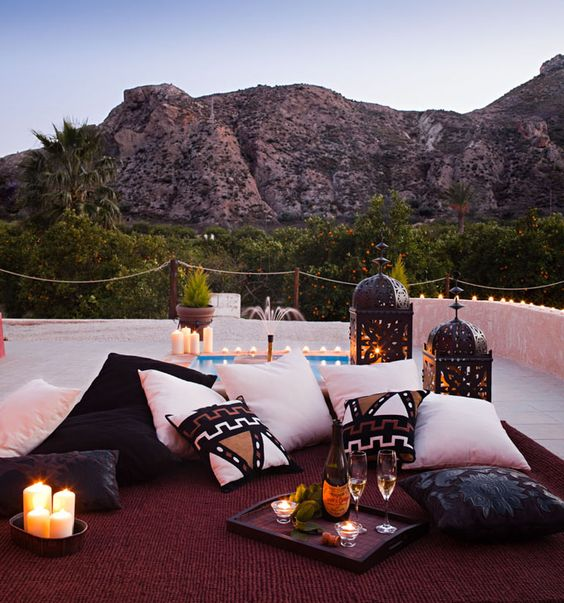 Love this Moroccan inspired outdoor space...: