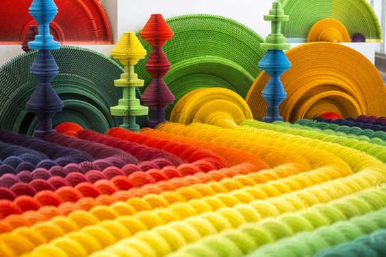 li hongbo examines the conflict of war + weapons with colorful paper gun accordions