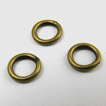 6mm closed antique brass plated jump rings-100 per package