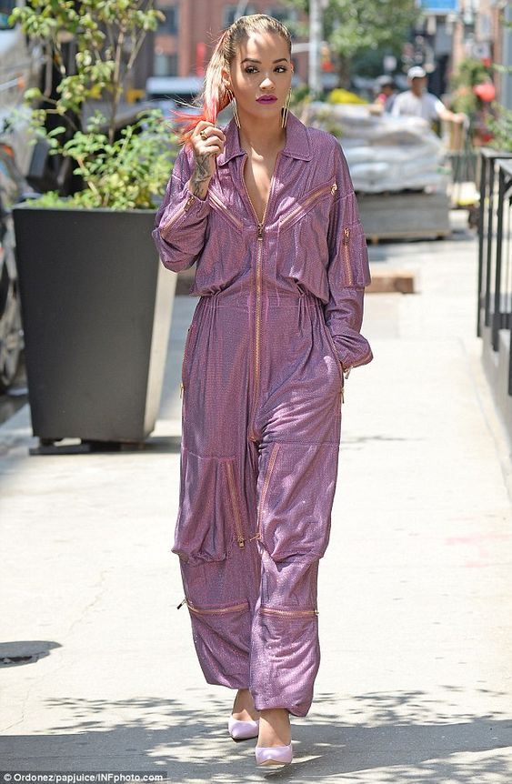 Grunge-chic:The one-piece was grungy in style, similar to a boiler suit with its baggy fi...