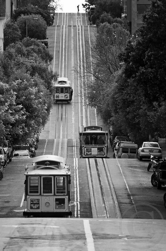 Cable cars descend and ascend the steep Hyde St., providing a unique form of public transportation.