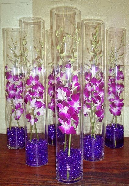 Tall orchids centerpiece can these go in water with for Tall candle centerpieces