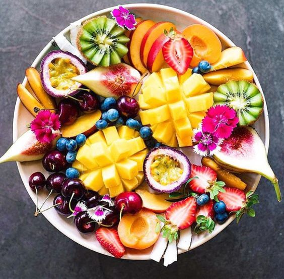 Summer is for pretty fruit platters. Shop our beachwear collection at matthewwilliamson.com