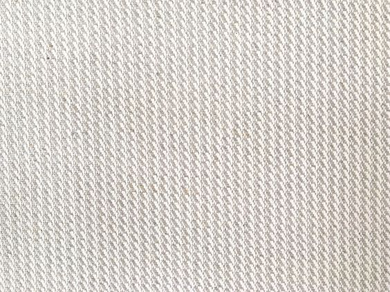 55% Linen/45% Cotton. Origin is Poland. Variation of houndstooth pattern. Great looking on a couch!