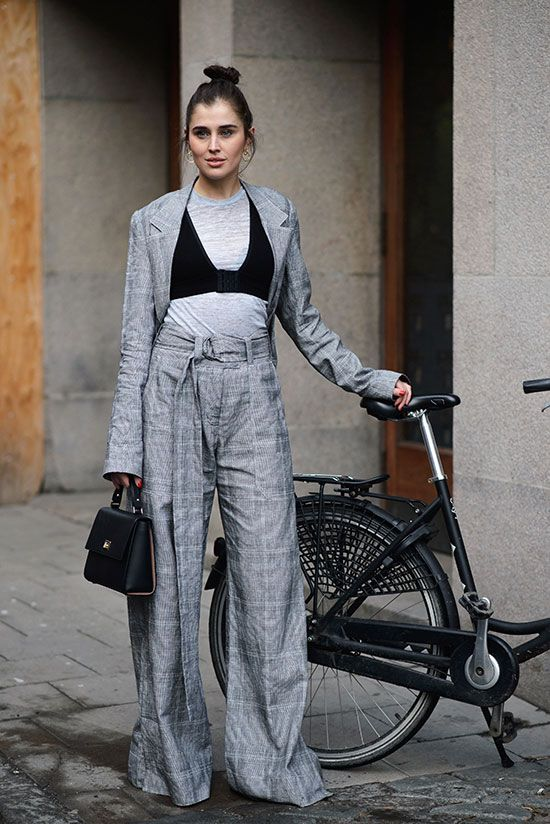 Grey plaid blazer, black bikini top over a grey t-shirt, grey plaid wide leg pants, black booties, black top handle bag - Fall layers, fall outfits, fall fashion, fashion, fashion trends 2017, fall fashion trends 2017, layered outfits, layered looks, street style, work outfits, office outfits, edgy outfits, trendy outfits.