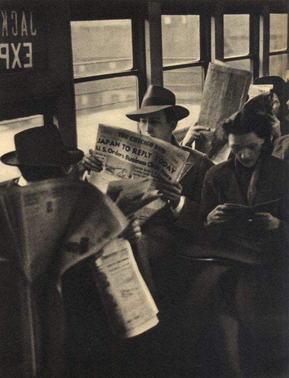 Reading the Chicago Sun (Times) on the L, 1942, Chicago  ~Via Stephanie Jewell