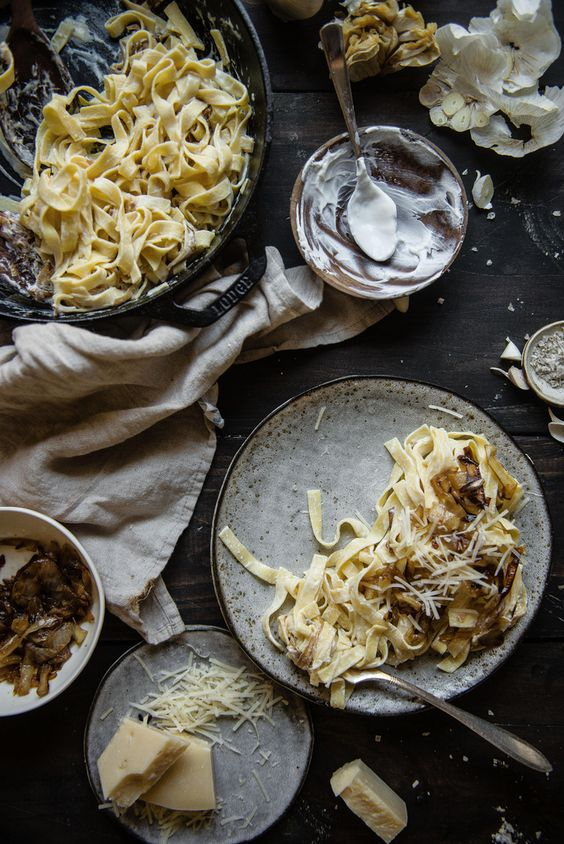 caramelized onion & roasted garlic pasta   two red bowls