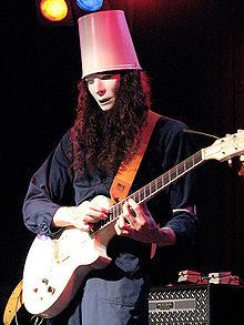 Brian Carroll, better known by his stage name Buckethead, is a virtuoso guitarist and multi instrumentalist who has worked within several genres of music. He has released 37 studio albums, four special releases and one EP. He has performed on over 50 more albums by other artists. His music spans such diverse areas as progressive metal, funk, blues, jazz, bluegrass, ambient, and avant-garde music.