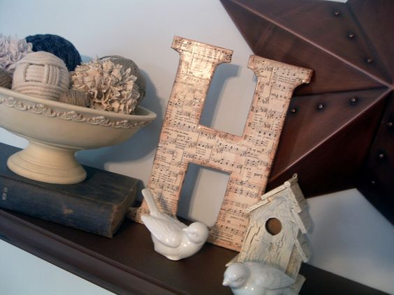 Make this DIY chipboard monogram with old cereal boxes and vintage sheet music. You can add a sheet music letter to your home decor for free!