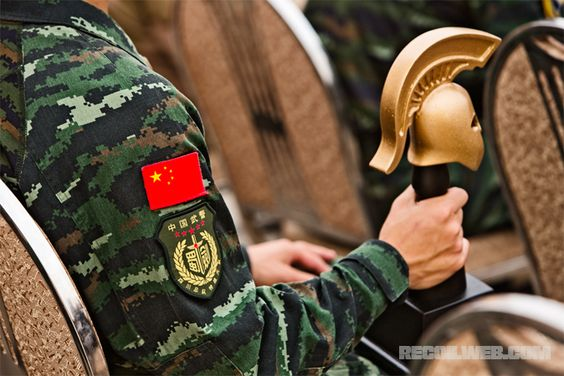 """Trophies are presented in an awards ceremony to The Warrior Competition's top performing teams.  Recoil Magazine comments:  """"Overall it was a good day – perhaps the funniest thing we observed was when a Jordanian SOF soldier broke the top of their trophy's helmet. One of his teammates looked over at a Chinese competitors seated nearby and asked if the trophy was made in China."""""""
