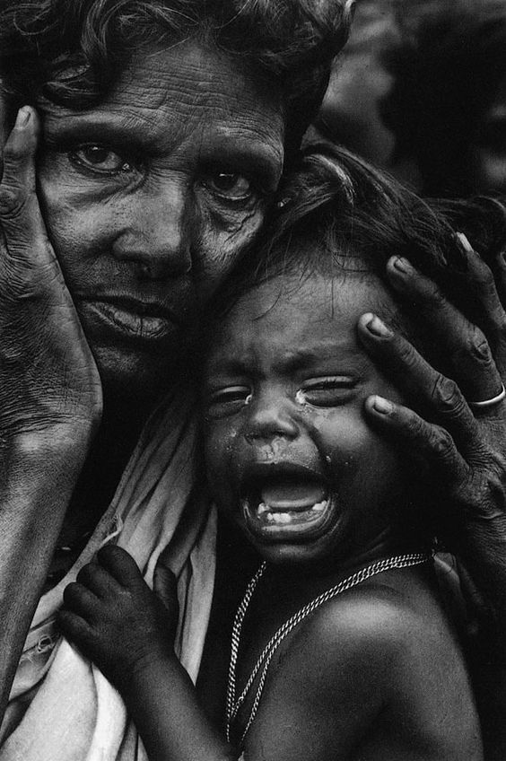 A mother and her child in a refugee camp from the war in Bangladesh by Don McCullin. 1971. S):