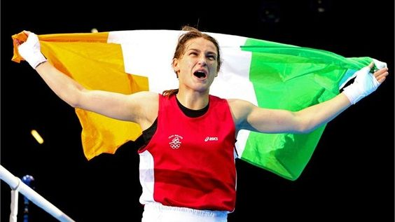 Katie Taylor of Ireland celebrates winning her bout against Sofya Ochigava of Russia during the women's Light Weight (60kg) Boxing final bout on Day 13.