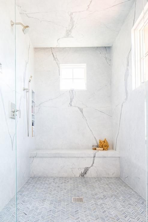 Walk Into A Large Master Bathroom Shower To Admire Thin Gray Marble Herringbone Floor Tiles And Marble Master Bathroom Shower Shower Floor Tile Marble Showers