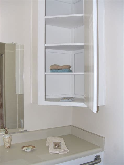 Simple White Wooden Wall Cabinet For Bathroom With Door Bathroom Corner Cabinet Bathroom Wall Storage Cabinets Wall Storage Cabinets
