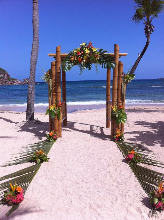 Beach Wedding Ideas Authentic Beach Wedding Bamboo Arch Covered In Tropical Flowers And Leaves