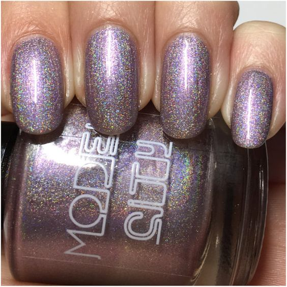SB27 June 2016 is a reddish purple holographic blend. In my photos I am wearing three thin coats and top coat.  Ingredients: Ethyl Acetate, Butyl Acetate, Nitrocellulose, Ethyl Alcohol, & Isopropyl Alcohol.  May Also Contain : Glitter, Triphenyl Phosphate, Propyl Acetate, Mica, Titaniuim Dioxide, Ferric Ferrocanide, Carmine, Ultramarine Violet Oxide, Aluminum, Acetone, Blue 1, Hydrogenated Plyisol, Palmitic Acid, Carbon Black, n-Butyl Alcohol, Iron Oxides, Red 7, Methyl Paraben…