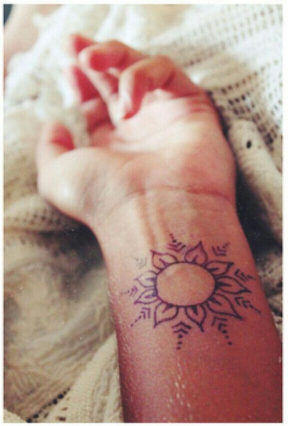Simple sun or flower wrist henna / tattoo design