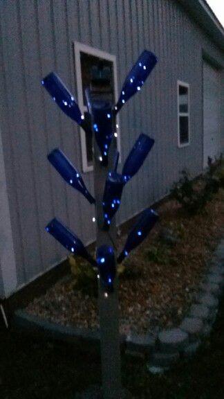 Wine bottle trees bottle trees and solar lights on pinterest for Diy solar wine bottle lights