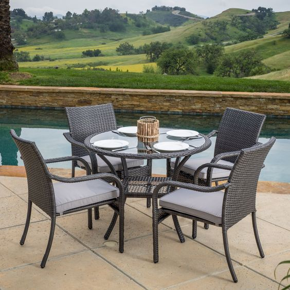 This set offers a solid foundation of metal and resin wicker juxtaposed with a sleek fabric to create a combination look that is not only trendy but functional.