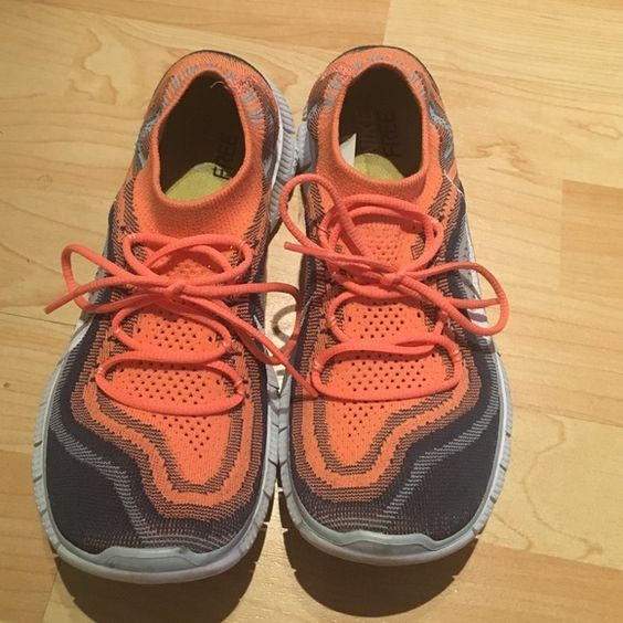 Nike flyknit 5.0 running shoes only worn 2 times, they run small so I suggest to buy if you're US 7 or 7.5 although they're size 8. Love them and wanted to keep them  Nike Shoes Sneakers