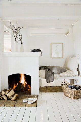 fireplace in bedroom/ white floors