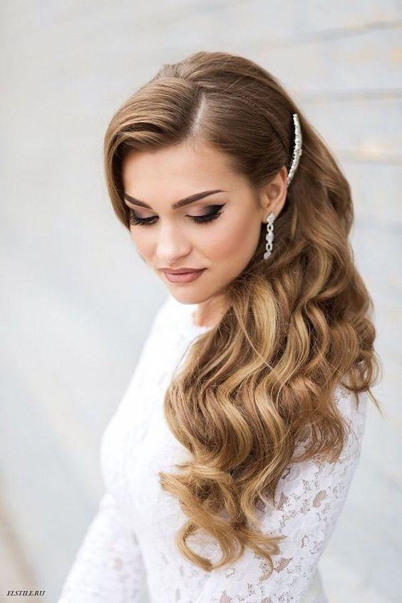Side-swept old Hollywood glam wedding hairstyle: