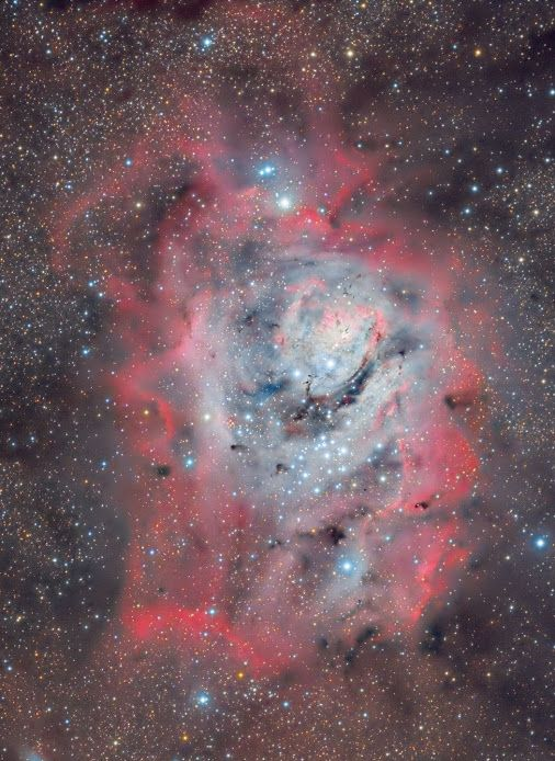 The #LagoonNebula between stars, dust and gas   The huge and majestic Lagoon Nebula is home for many young stars and hot gas. It has 100 light years across, lies about 5000 light years away and is so big and bright that can be seen without a telescope in the constellation Sagittarius.