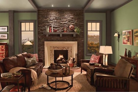 Olive green paint with stone accent wall cream recessed fireplace lifts the deeper colours for Country living room paint colors