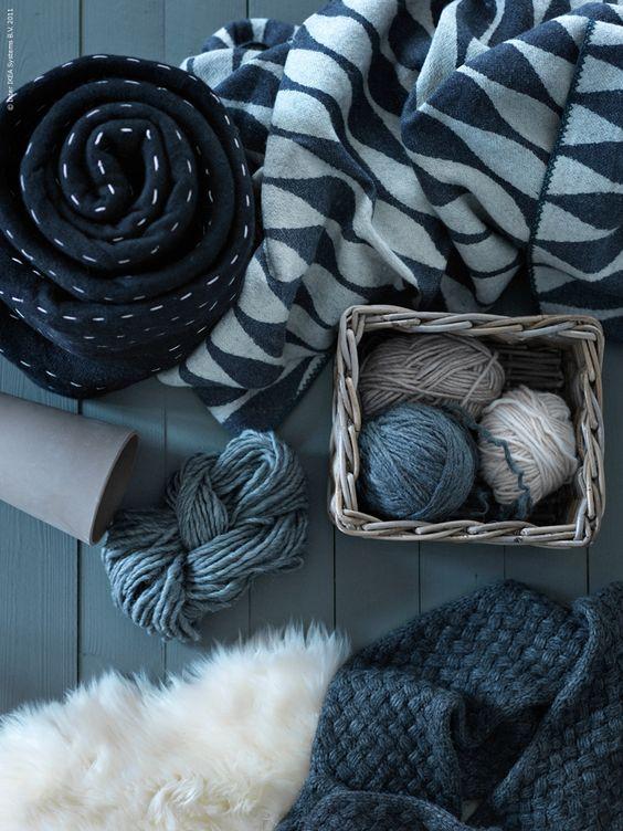 Grey, white, wool, sheepskin, wood, clay, basket, fiber. Natural.