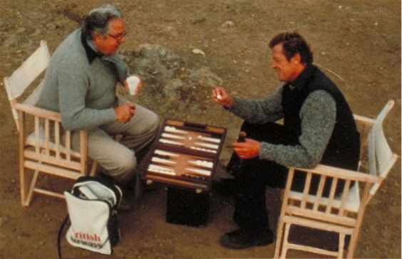 """Behind the scenes of """"For Your Eyes Only"""" with Roger Moore and Cubby Broccoli playing backgammon"""