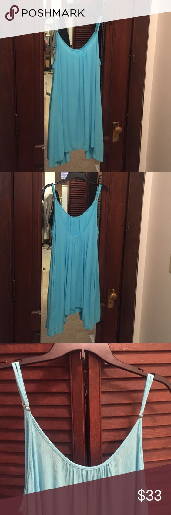 Elan Flare Dress Light blue, flowy summer dress. Has pockets and adjustable straps. NEVER BEEN WORN, NEW WITH TAGS. Elan Dresses Midi