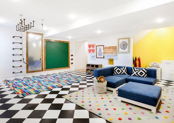Stylish Contemporary Basement Playroom Is Clad In Black And White Checkered Floor Tiles Complemented With A Candy D Basement Playroom Blue Sectional Home Decor