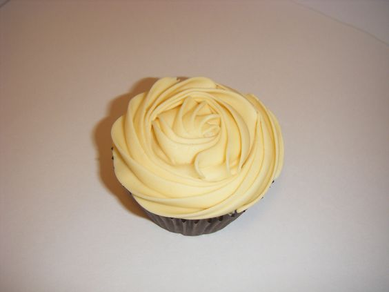 Delicious Butterscotch cupcake. A rose piping nozzle has been used to get the delicious rose-like buttercream on top...