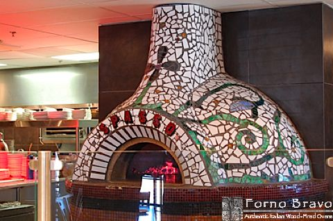 Who wouldn't want a colorful mosaic wood-fired pizza and bread oven in their home!