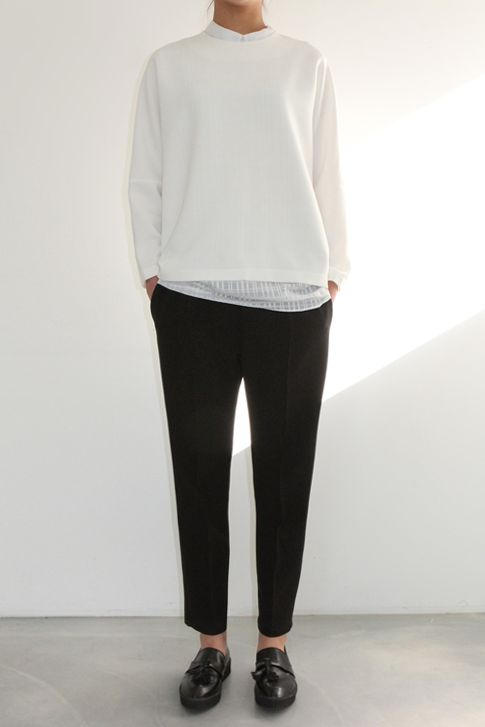 white pullover, slightly cropped black pants: