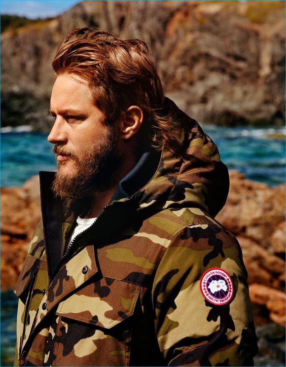 Travis Fimmel sports a camouflage jacket for Canada Goose's fall-winter 2016…