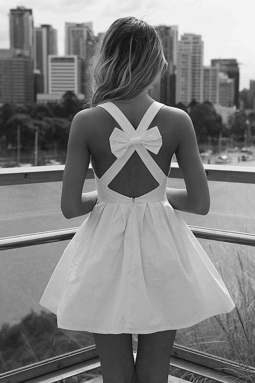 "Liana is looking for this dress. ""This beautiful white dress with a cutout back."""