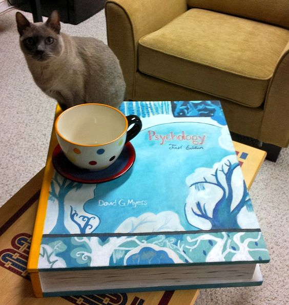 Giant book and teacup with Tonkinese cat