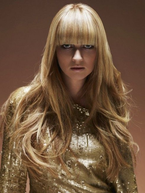Blunt, blond bangs. This adds definition to this long layered do. #bangs #longhairdontcare #blond #layeredhair