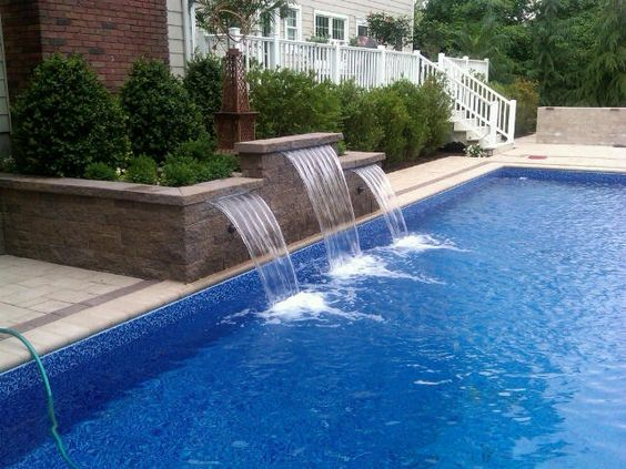 add beautiful waterfalls to your pool cambridge pavingstones provides outdoor water features to. Black Bedroom Furniture Sets. Home Design Ideas