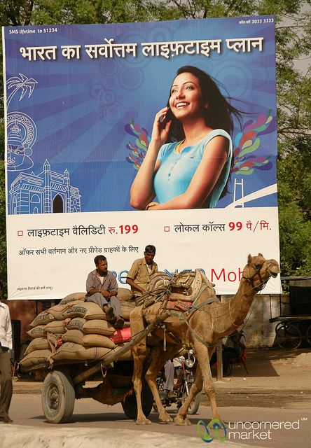 #A camel cart in front of a new advertisement for mobile phone services in Bikaner, India.     FREE MONEY/Revenue Sharing! DON'T GET LEFT BEHIND! ([Free money[wealth[ money[ online wealth[ make money online[ online cash[ financial Independence[  home Business[ Internet Business[create wealth[Retirement Plan).  http://eimimo.com/?ref=106983    Like, Share, Pin! Thanks :)