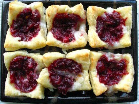 """Cranberry Brie Bites: """"This will make your party table look very festive. They are easy to make and the brie cheese with the cranberry is a great combination."""" -Charlotte J"""