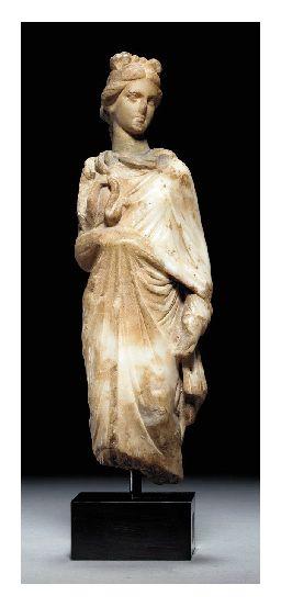 A ROMAN MARBLE FIGURE OF HYGIEIA CIRCA 1ST CENTURY B.C.-1ST CENTURY A.D.